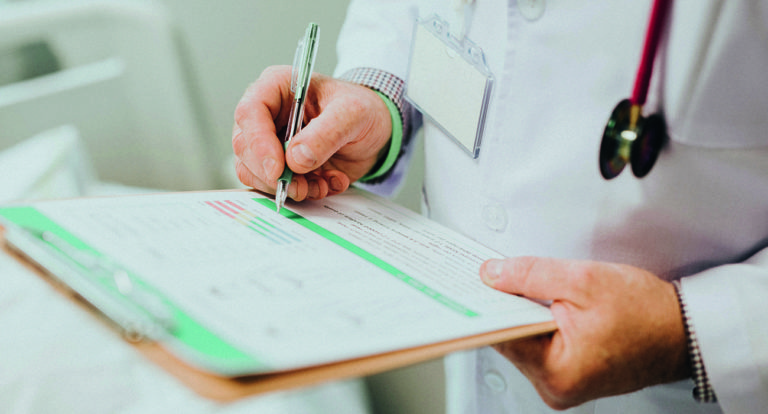 Doctor in white shirt with a clipboard diagnosing Legionnaires' disease