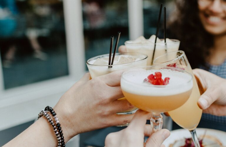 A group of people enjoying cocktails